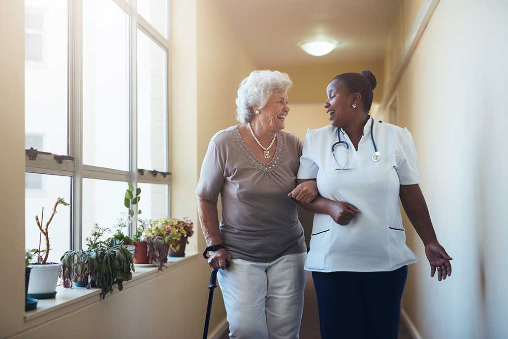 Lady-with-her-carer-in-corridor